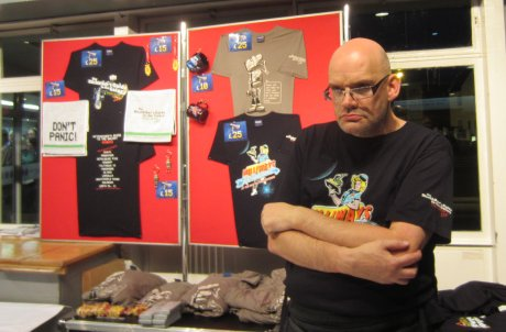 Merchandising Marvin selling Don't Panic souvenirs